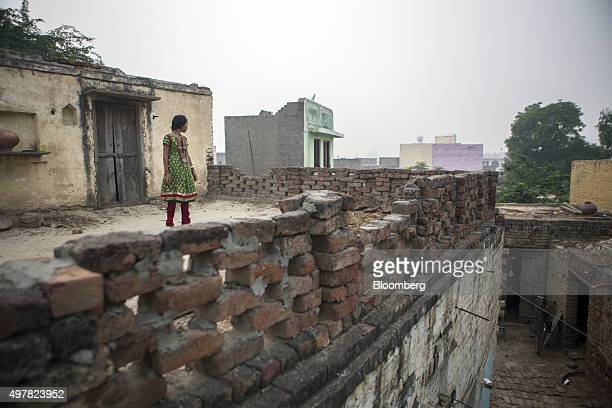 The daughter of day laborer Kamlesh stands on the terrace of her home in Lahli village Haryana India on Tuesday Nov 3 2015 After years of...
