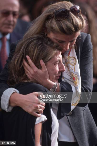 The daughter of former Franco minister Jose Utrera Molina Maria Victoria Utrera is consoled by a woman during his father's funerals in Nerja on April...