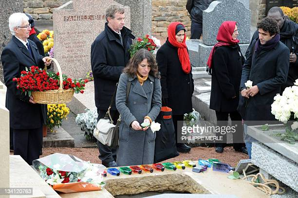 The daughter of former French president François Mitterrand and his mistress Anne Pingeot Mazarine Pingeot throws a white rose on the coffin of...
