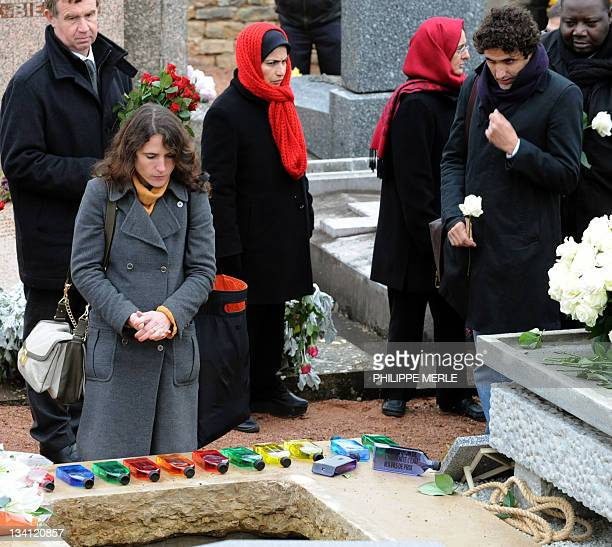The daughter of former French president François Mitterrand and his mistress Anne Pingeot Mazarine Pingeot and her partner Mohammed Ulad pay respect...