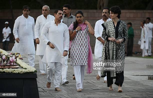 The daughter of former Indian prime minister Rajiv Gandhi Priyanka Gandhi her husband Robert Vadra and their daughter take part in a remembrance...