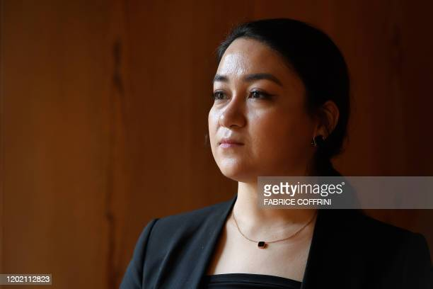 The daughter of jailed Uighur intellectual Ilham Tohti Jewher Ilham poses during an interview with AFP on the sideline of The Geneva Summit for Human...