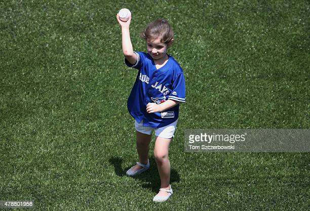 The daughter of Marco Estrada of the Toronto Blue Jays throws out the first pitch on Fatherâs Day before the start of their MLB game against the...
