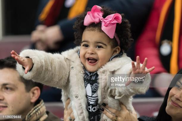 the daughter of Marcos do Nascimento Teixeira of Galatasaray SK during the UEFA Europa League round of 32 match between Galatasaray SK and SL Benfica...