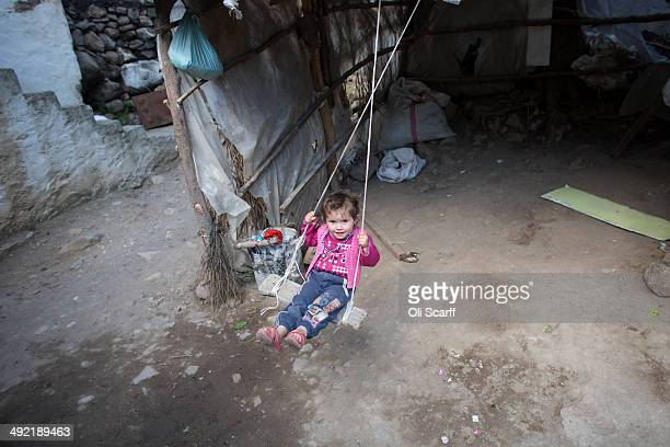 The daughter of miner Bilal Ay, who died in the explosion at Soma mine, plays on a swing at their home in the hamlet of Elmadere close to the mine...