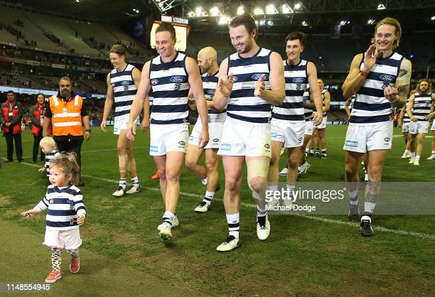 The daughter of Mitch Duncan of the Cats celebrates the win during the round eight AFL match between the North Melbourne Kangaroos and the Geelong...