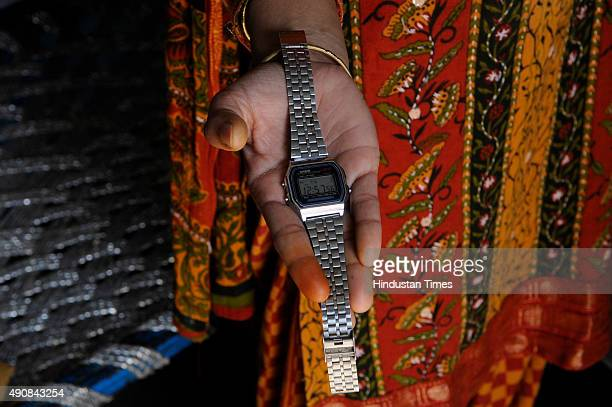 The daughter of Mohammad Akhlaq shows the wrist watch of her father at Bisada village on October 1 2015 in Greater Noida India Akhlaq was killed and...