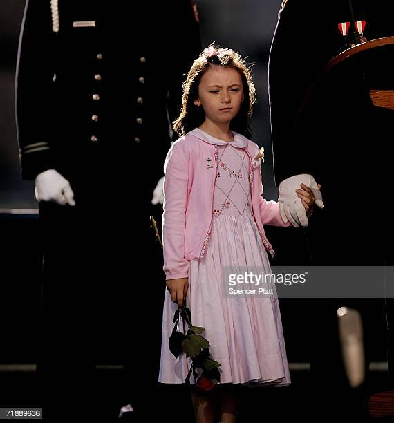 The daughter of police officer Moira Smith who was killed on 9-11, Patricia Smith, holds the hand of her father James Smith on stage during the...
