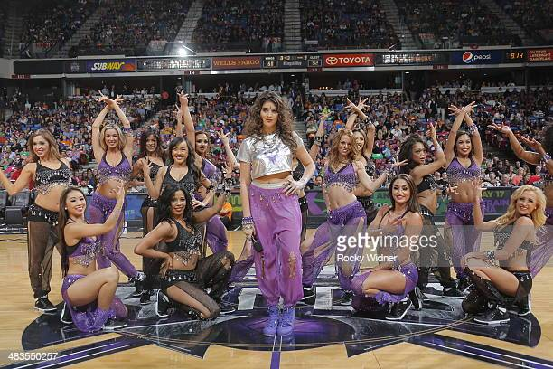 The daughter of Sacramento Kings owner Vivek Ranadive Anjali Ranadive entertains the fans with the Sacramento Kings dance team during halftime of the...