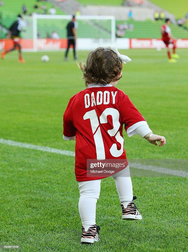 The daughter of Shane Rexhepi of the City runs out in see him in the warm up during the FFA Cup Semi Final match between Hume City and Melbourne Victory at AAMI Park on October 28, 2015 in Melbourne, Australia.