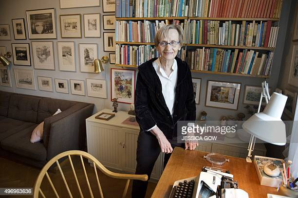 The daughter of Swedish writer Astrid Lindgren Karin Nyman stands next to her mother's desk at her appartment in Stockholm on November 13 2015 From...