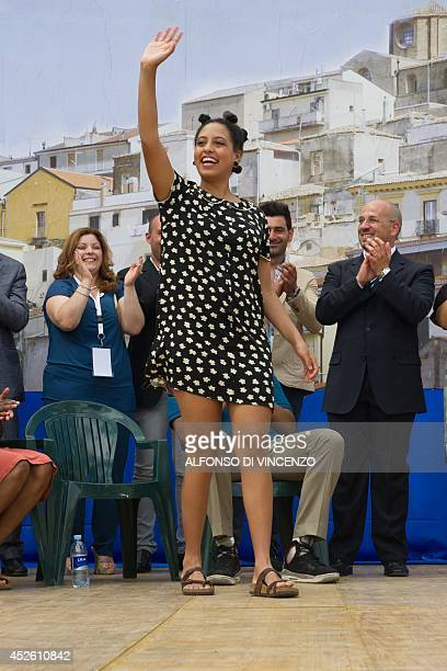 The daughter of the mayor of New York city, Chiara di Blasio, waves the villagers in Grassano during a welcoming ceremony upon the arrival of the...