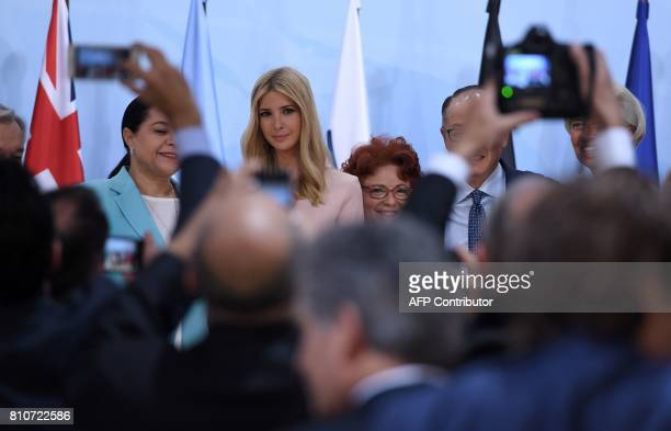 The daughter of the US President Ivanka Trump poses with other participants of the panel discussion 'Launch Event Women's Entrepreneur Finance...