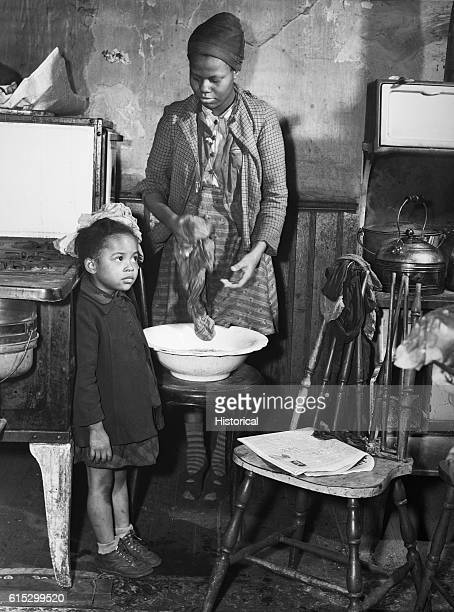 The daughters of a defense worker living in the slum district of Norfolk, Virginia. March 1941.