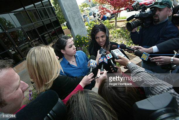 The daughters of accused murderer Marcus Wesson Rosie Solorio and Kiani Wesson talk to the media in front of the court house after Wesson's court...