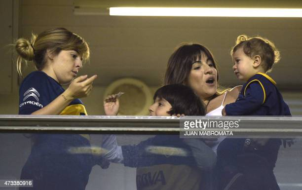The daughters of Argentina's former fooball star Diego Maradona Dalma and Gianinna gesture before the start of the Copa Libertadores 2015 round...