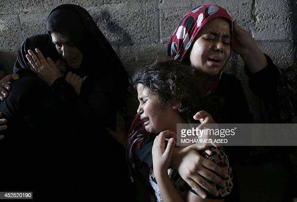 The daughters of Hasan Baker 60yearsold grieve during his funeral in Gaza City on July 22 2014 A series of Israeli air strikes early killed seven...