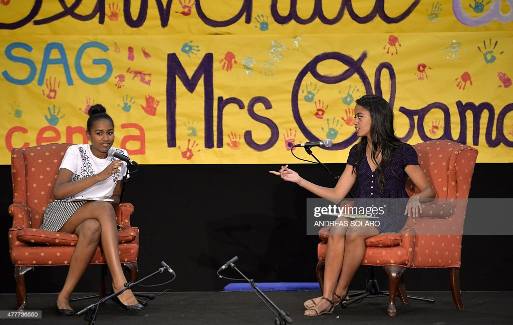 The daughters of the US president Sasha (L) and Malia Obama read fairy tales to children at the United States and Nato military base in Vicenza on June 19, 2015.