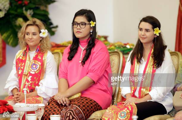 The daughters of US Vice President Mike Pence Charlotte and Audrey sit with the daughter of Indonesia's President Joko Widodo Kahiyang Ayu as they...