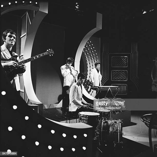 The Dave Clark Five group portrait on the set of TV show Thank Your Lucky Stars 1965 LR Rick Huxley Denis Payton Dave Clark Mike Smith