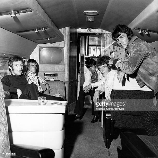 The Dave Clark Five pose for a portrait on aboard a small jet in circa 1967. Mike Smith, Lenny Davidson, Denis 'Denny' Payton, Rick Huxley, Dave...