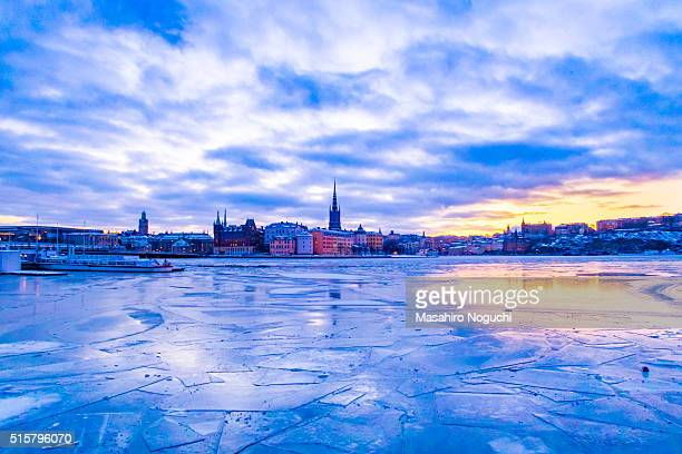 The dawn at the waterfront covered with ice in central Stockholm