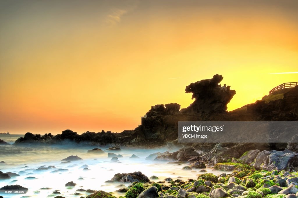 The dawn of Jeju Yongduam VD702 : Stock Photo