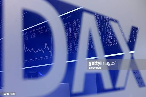 The DAX Index curve and financial data are reflected in a sign inside the Frankfurt Stock Exchange, in Frankfurt, Germany, on Friday, Aug. 5, 2011....