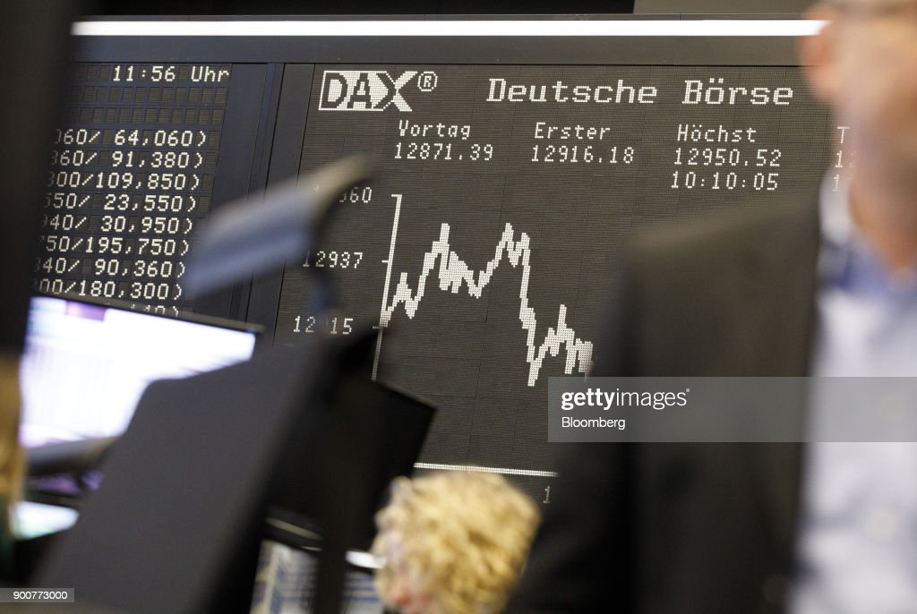 The DAX Index curve is displayed as the second iteration of the Markets in Financial Instruments Directive (MiFID II) comes into force at the Frankfurt Stock Exchange, operated by Deutsche Boerse AG, in Frankfurt, Germany, on Wednesday, Jan. 3, 2018. After seven years of preparation, $2 billion in compliance costs and one false start, the biggest shake-up to European regulation in a decade is finally here. Photographer: Alex Kraus/Bloomberg via Getty Images