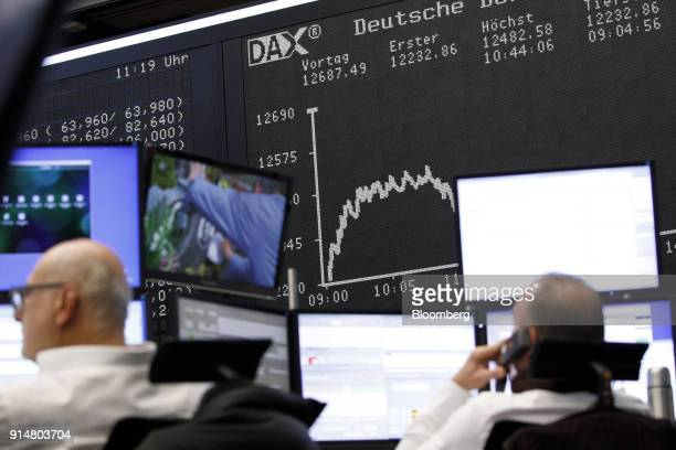 The DAX Index curve is displayed as traders monitor financial data inside the Frankfurt Stock Exchange operated by Deutsche Boerse AG in Frankfurt...