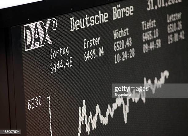 The DAX index curve is displayed on a board at the Frankfurt Stock Exchange during the last day of January trading in Frankfurt Germany on Tuesday...