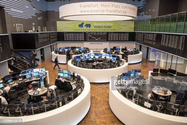 The DAX Index curve shows the downward trajectory at the Frankfurt Stock Exchange of the Deutsche Boerse AG on March 2, 2020 in Frankfurt, Germany....