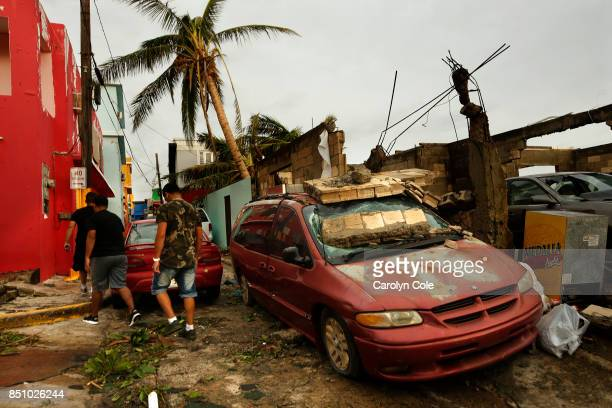 The day after Hurricane Maria made a direct hit on Puerto Rico with winds up to 150mph residents of La Perla close to Old San Juan begin to clean up