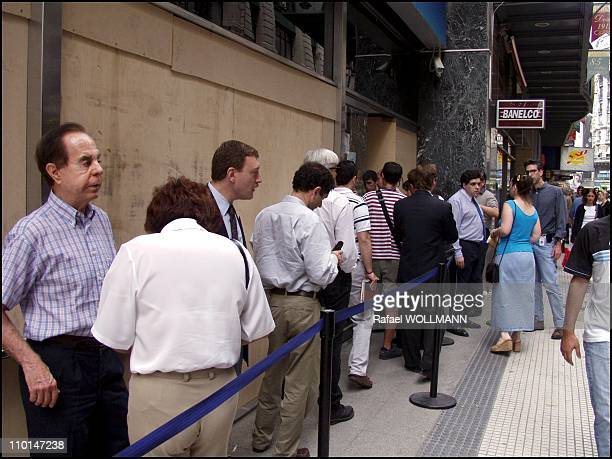 The day after the disturbs and De La Rua's quit people start to reconstruct and go to banks to get some money before the obvious devaluation next...