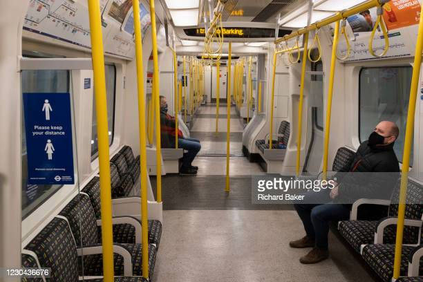 The day after the government introduced a third Coronavirus pandemic national lockdown, effectively a Tier 5 restriction, a tube train carriage...