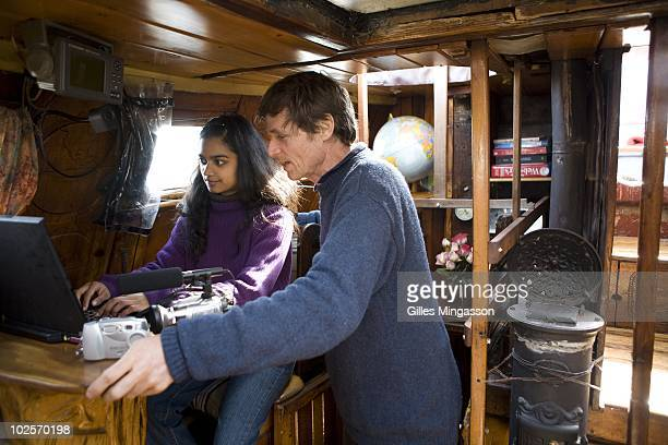 The day before setting sail for the world's longest sea voyage American sailor Reid Stowe and his girlfriend Sonya double check electronic equipment...