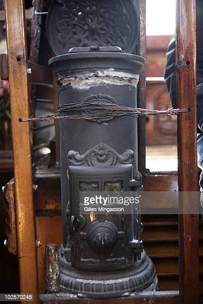 The day before setting sail for the world's longest sea voyage American sailor Reid Stowe double checks the stove in his handbuilt wooden 70 foot...