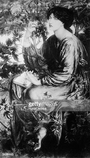 'The Day Dream' by English preRaphaelite artist Dante Gabriel Rossetti A darkhaired woman sits alone in a lush garden with an open book on her lap