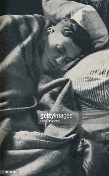 'The day is over' 1941 An airman gets a good night's rest From Air of Glory by Cecil Beaton [His Majesty's Stationery Office London 1941]Artist Cecil...