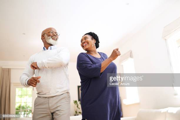 the day isn't complete until they've had a dance together - black people having fun stock photos and pictures