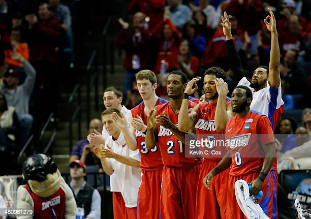 The Dayton Flyers bench reacts during a regional semifinal of the 2014 NCAA Men's Basketball Tournament against the Stanford Cardinal at the...