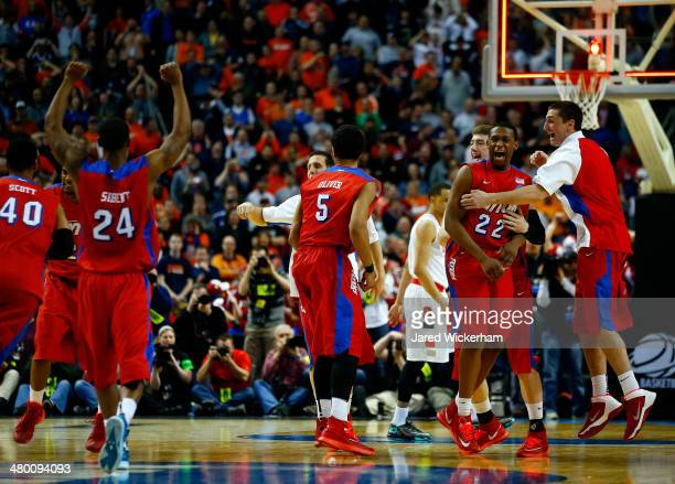 The Dayton Flyers celebrate after defeating the Syracuse Orange 5553 in the third round of the 2014 NCAA Men's Basketball Tournament at the First...