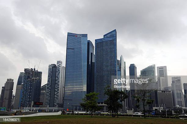 The DBS Group Holdings Ltd logo is displayed atop Tower 3 of the Marina Bay Financial Centre center left which houses the company's new headquarters...