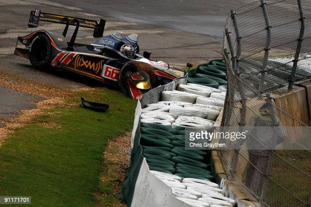 The de Ferran Motorsports Acura ARX-02a driven by Scott Dixon crashes into the barrier during the American Le Mans Series Petit Le Mans on September...