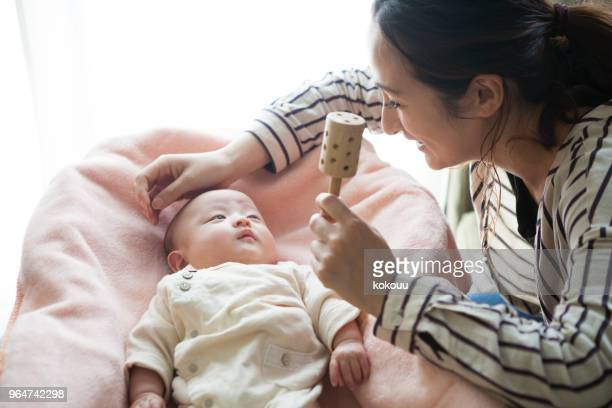 the dead baby is being toured with a toy. - toy rattle stock pictures, royalty-free photos & images
