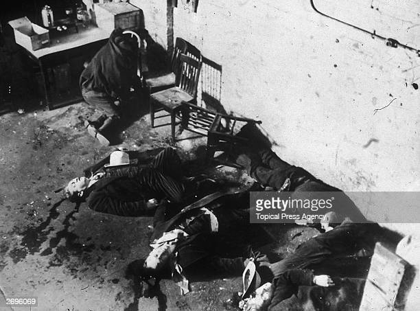 The dead bodies of gangsters from George 'Bugs' Moran's gang, murdered at the garage at 2122 North Clark, Chicago, by Al Capone's gang,led by...