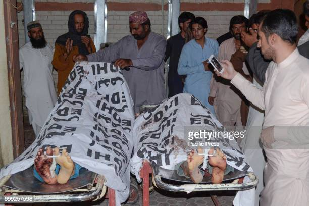 QUETTA BALOCHISTAN PAKISTAN The dead bodies of victims laid out for transfer to a hospital A suicide bombing attack on Balochistan Awami Party corner...