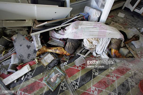 The dead body of a Lebanese civilian lies covered in debris as a result of the Israeli bombing campaign on August 1 2006 in the village of Ainata...