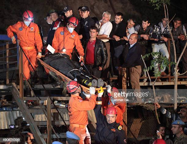 The dead body of a miner is carried away May 15, 2014 in Soma, a district in Turkey's western province of Manisa, Turkey. An explosion and fire in...
