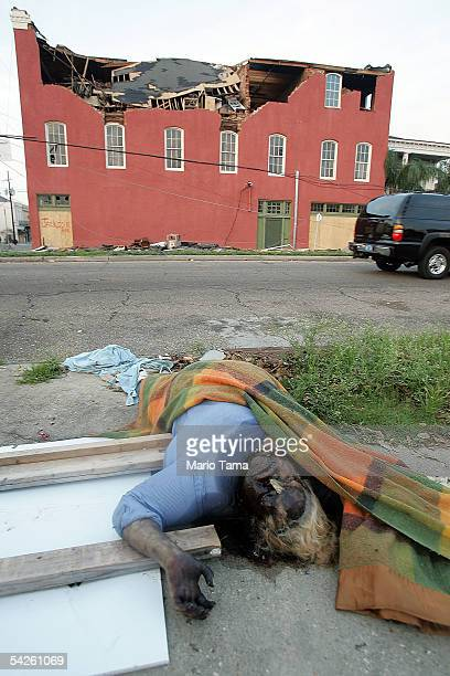 The dead body of a woman is seen on a downtown street September 2 2005 in New Orleans Louisiana Chaos still reigned in much of New Orleans as corpses...